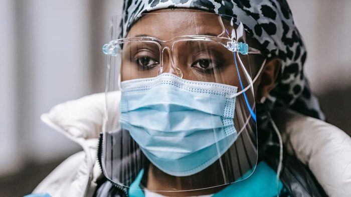 Black female nurse wearing personal protective equipment